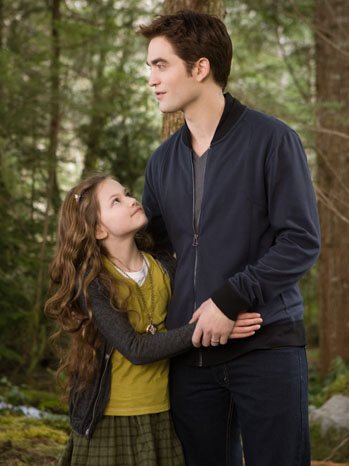 Edward (Robert Pattinson) with daughter Renesmee (Mackenzie Foy) as they stroll through the woods. THE TWILIGHT SAGA: BREAKING DAWN-PART 2 Ph
