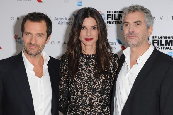 Alfonso Cuarón, Sandra Bullock and producer David Heyman